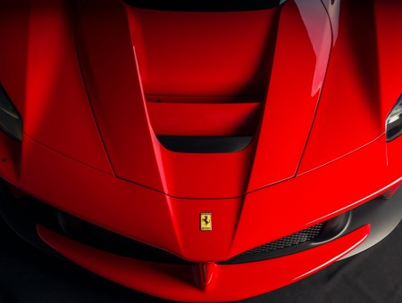 The hood of the red sports Ferrari