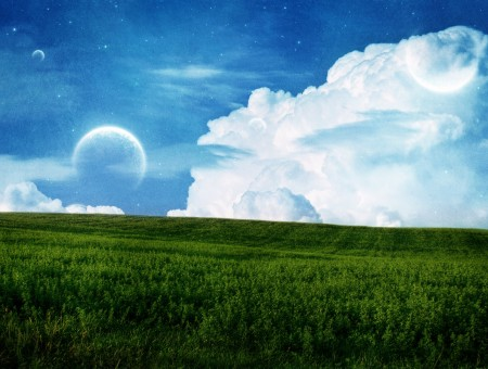 Clouds with the moon and grass field