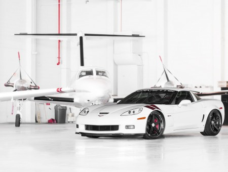 White Corvette in the hangar