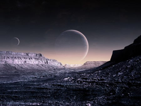 A view of two moons in a canyon