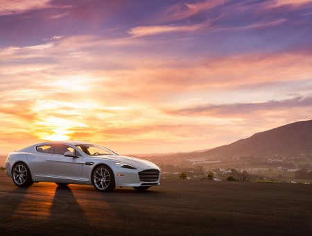 White Aston Martin and sunset