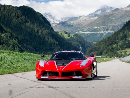 Red Ferrari on mountains background