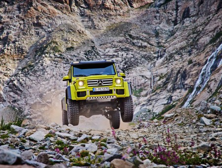 Gold Mercedes-Benz G500 rides off-road