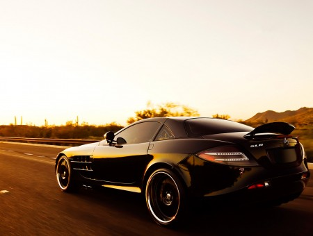 black mercedes on road
