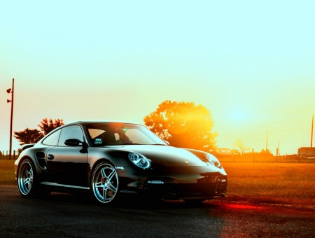 black porshe and sunny road