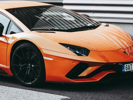 Orange perfect Lamborghini on road