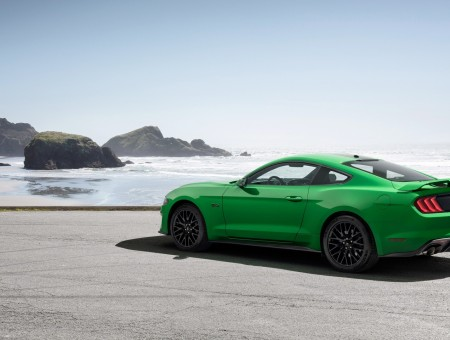 Green ford mustang on beach