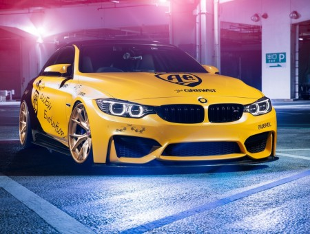 Yellow bmw on road