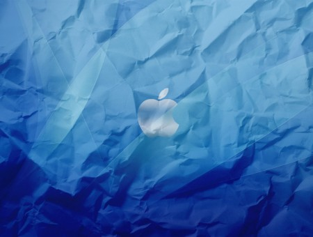 Apple logo on blue paper