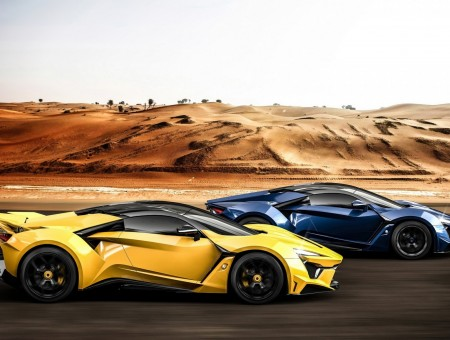 Two hypercars ride on road
