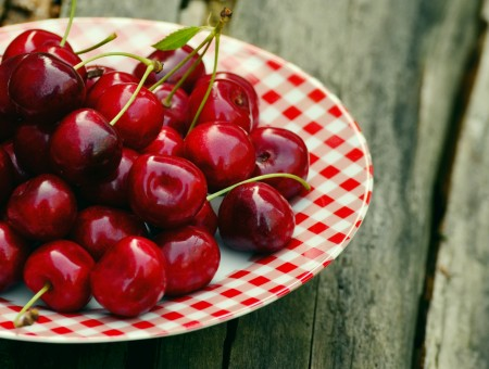 cherries on the red plate